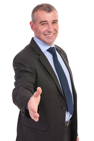 business man offering a handshake with a smile on his face. on a white background photo