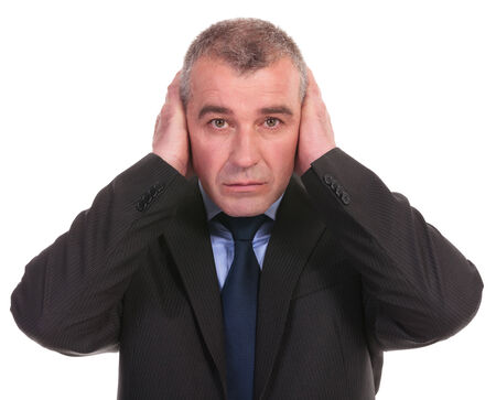business man covering his ears while looking into the camera. on a white background Stock Photo