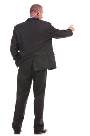 full length back view picture of a business man pushing an imaginary button while holding his other hand in his pocket. on a white background photo