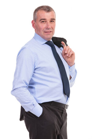 business man standing with his jacket over his shoulder and a hand in his pocket while looking into the camera. on a white background photo