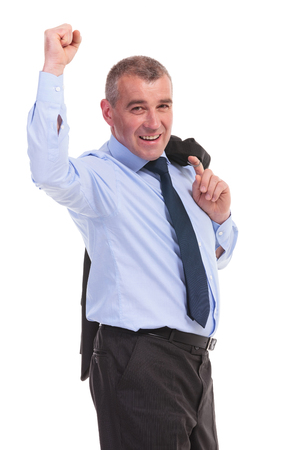 business man holding his jacket over his shoulder and cheering with a smile for the camera. on a white background photo