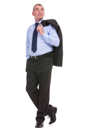 full length picture of a business man holding his jacket over his shoulder and a hand in his pocket while looking away from the camera. on a white background photo