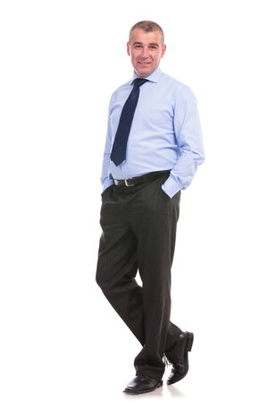 full length picture of a business man standing with his hands in his front pockets and looking into the camera. on a white background photo