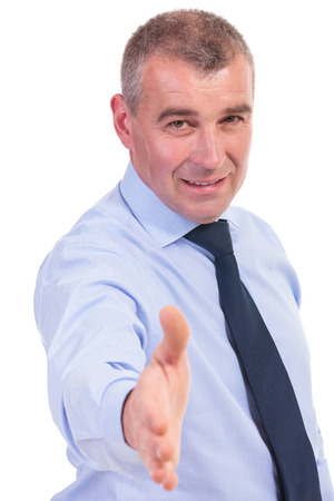 business man offering a handshake with a smile on his lips. on a white background photo
