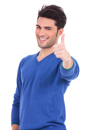 making up: positive smiling man making the ok thumbs up sign on white background Stock Photo