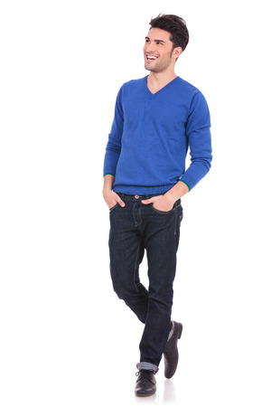 side light: young casual man with hands in pockets looking away from the camera to his side