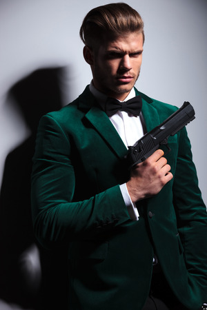 james bond: portrait of a young man James Bond asassin type looking at the camera Stock Photo