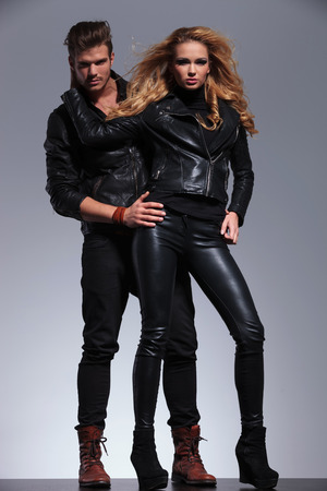 man and woman models in leather clothes looking at the camera photo