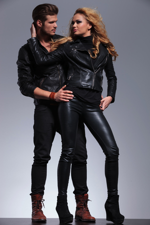 man and woman in fashionable leather clothes looking at each other  photo
