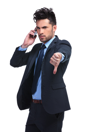 unshaved: young business man with very bad news on the phone