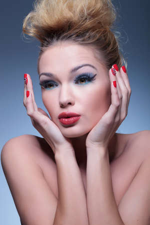 side view of an amazed beauty woman with nice makeup and red nails photo