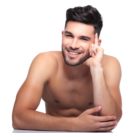 smiling and pensive beauty naked man is laughing on a white background photo