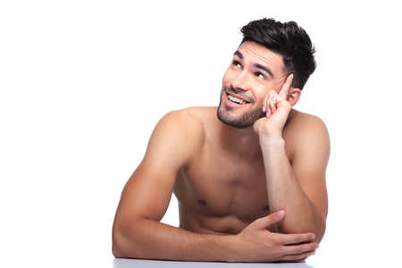 boy  naked: young smiling naked beauty man is looking up to his side on white background Stock Photo