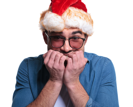 young man in santa hat can't wait for the christmas to come photo