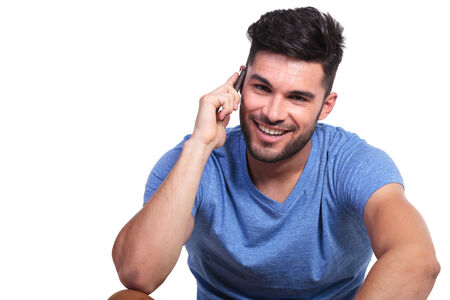 smiling man is talking on the phone on white background photo