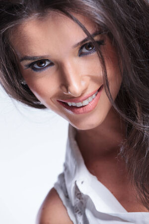closeup picture of a young beauty woman smiling for the camera photo