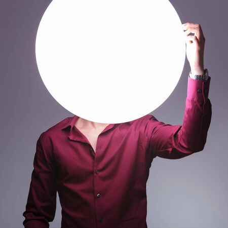 confused bright man is having a problem and scratches his big ball head  photo