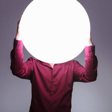 man with big ball of light as a head photo
