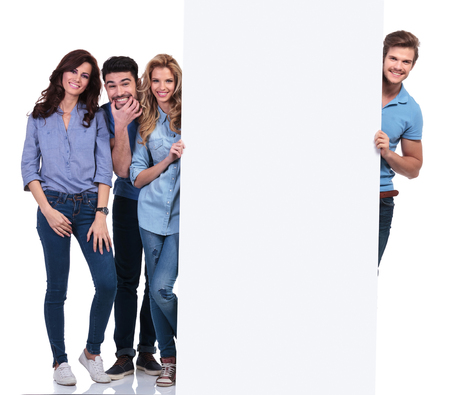 pannel: group of casual people fooling around and presenting a blank board on white background