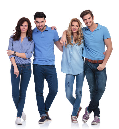 group picture: full body picture of a small group of casual young happy peolple standing together on white background