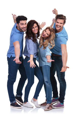 happy casual people inviting you to join them on white background photo