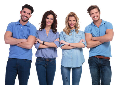 smiling group of casual young people standing with hands crossed on white background photo