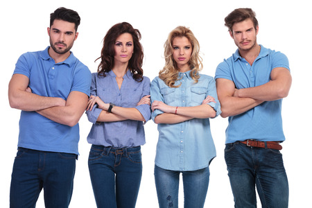angry blonde: casual group of young serious people looking at the camera on white background