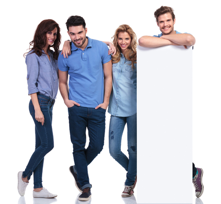 relaxed group of people showing a blank board on white background photo