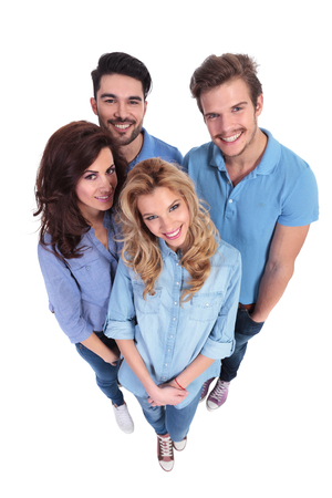 wide angle picture of group of casual people smiling to the camera on white background photo