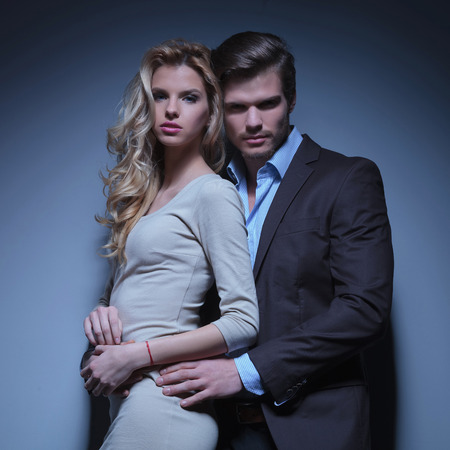 Portrait of young couple in love posing at studio  photo