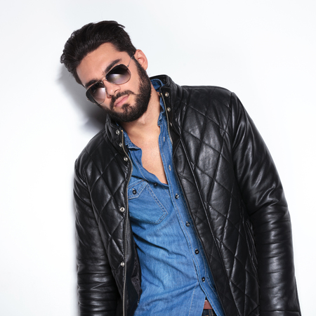 male fashion model: fashion male model in leather jacket and sunglasses posing in studio