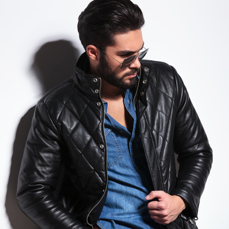 side view of a dramatic fashion male model posing in studio photo
