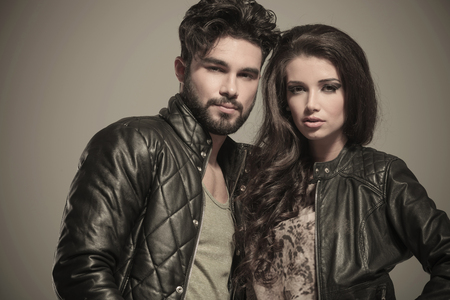 closeup picture of an embraced modern couple in leather jackets