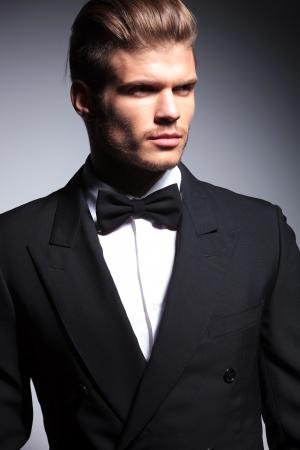elegant business man: face of a handsome caucasian man in tuxedo posing in studio