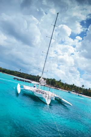 catamaran in a bay near saona island in the caribbean sea