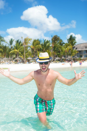 cool man welcoming you to the beautiful tropical island photo