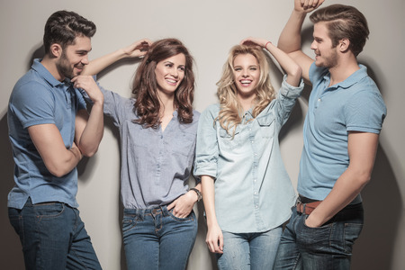 happy group of young casual fashion people laughing together  photo