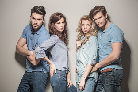 fashion models in blue jeans and casual polo shirts posing in studio photo