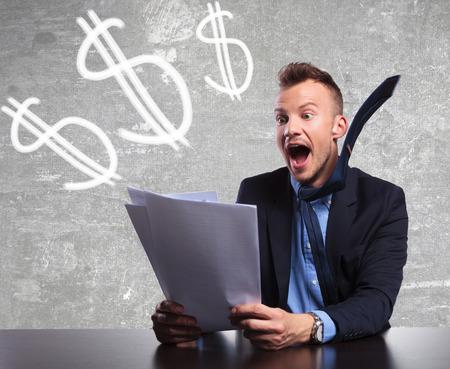 shocking: surprised businessman reading shocking good results Stock Photo