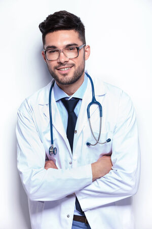 young male medic standing with his arms crossed while smiling for the camera. Stock Photo - 27109016