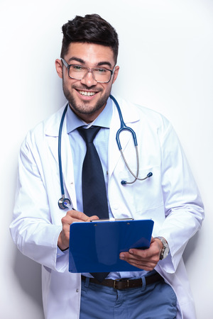young medic writes prescription Stock Photo - 27109030