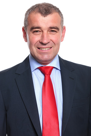 business for the middle: close up portrait of a middle aged business man smiling for the camera. isolated on a white
