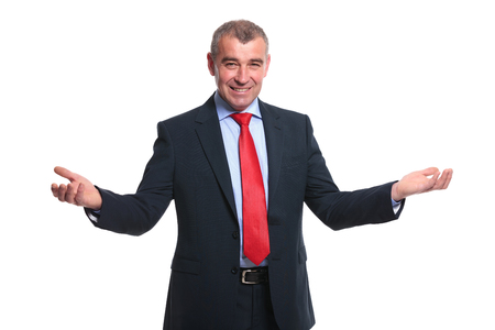 portrait of a mid aged business man welcoming you with a smile and his arms wide open. isolated on a white  photo