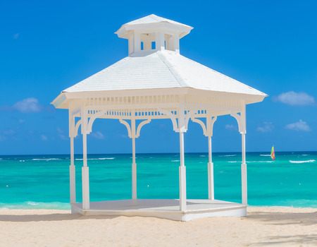 wedding arch  on the beach of punta cana, dominican republic photo