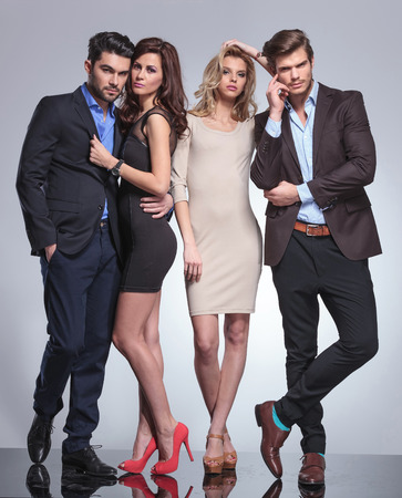 small group of elegant people posing in studio  Stock Photo