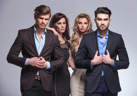 elegant business man: elegant group of young people posing in studio