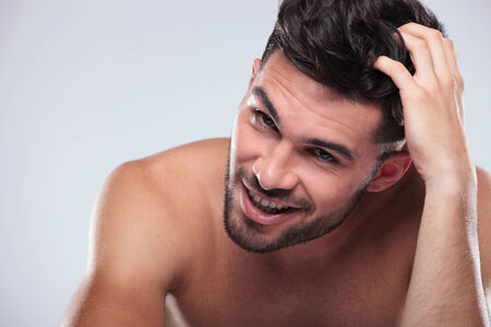 boy  naked: happy naked man scratching his head and smiles to the camera