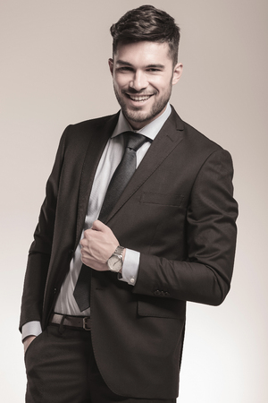 young relaxed business man laughing for the camera in studio photo
