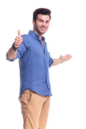 young man showing something and making the ok thumbs up hand sign