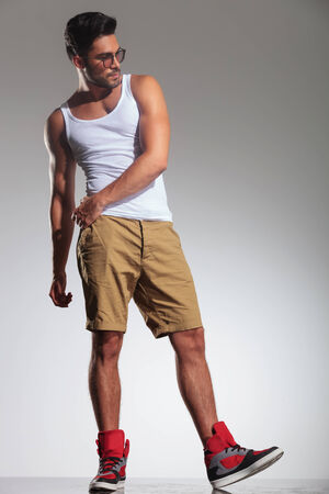undershirt: man stepping to his side and looking away from the camera